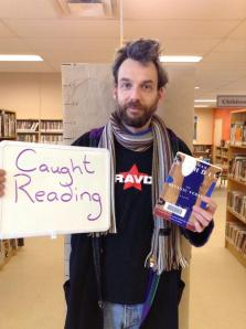 Me caught reading 'The Satanic Verses' at Bonnechere Union Public Library, Eganville