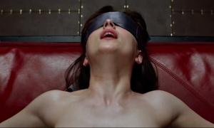 Dakota Johnson gets a good night's sleep thanks to a sleep-mask she bought off Sky Mall. source: The Guardian